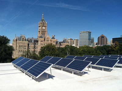 Solar installation on the top of The Leonardo, with a view of the Salt Lake City-County Building.