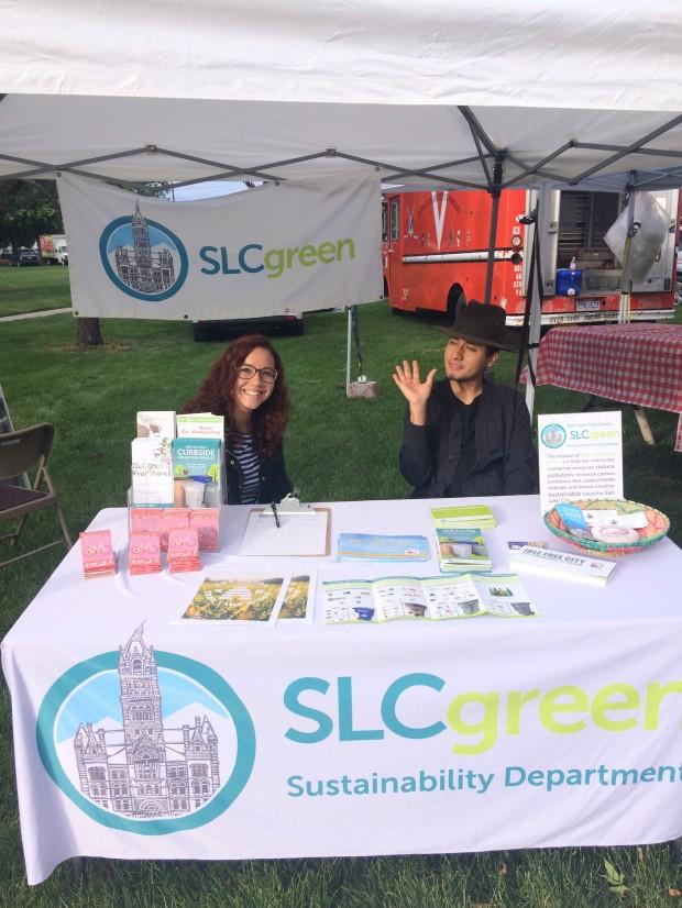 SLCgreen Interns Linda Derhak and Atticus Olmedo tabling at the Downtown Farmers Market.