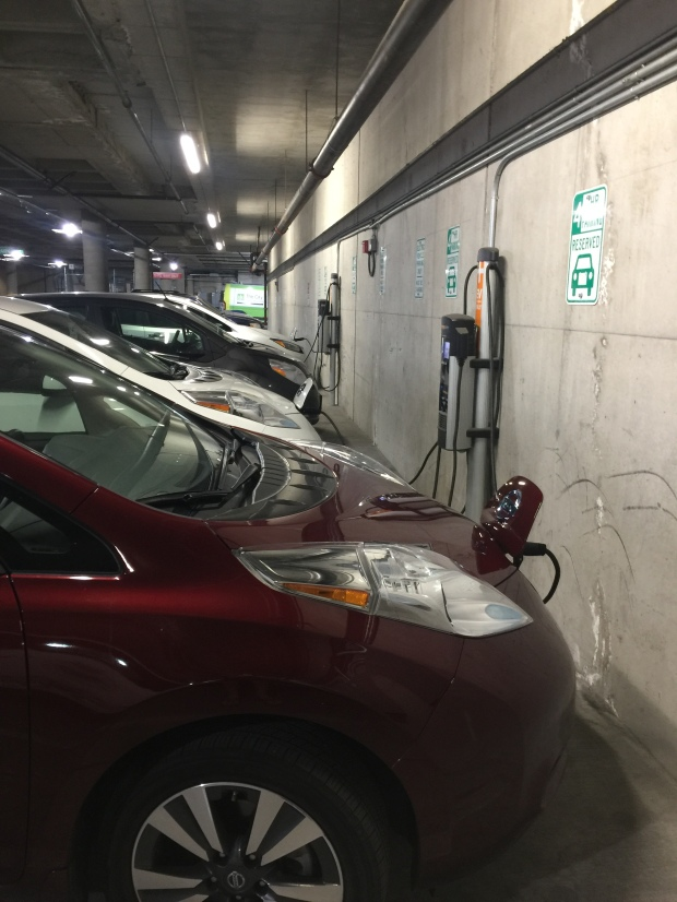 Electric vehicles charging at Downtown Library station.
