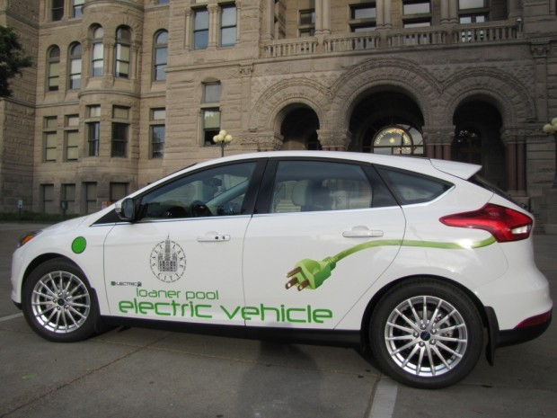 Salt Lake City loaner pool electric vehicle parked outside city and county building.
