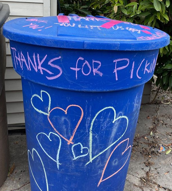 "Photo of SLC recycling bin with chalk decorations reading ""Thanks for picking up"" and different hearts."