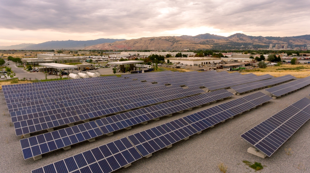 Photo of Salt lake City's solar farm near Fleet Department. Photo taken looking north east across Salt Lake City towards mountains.