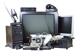 Old and used electric home waste. Obsolete pc computer, telephone, CRT monitor, DVD.