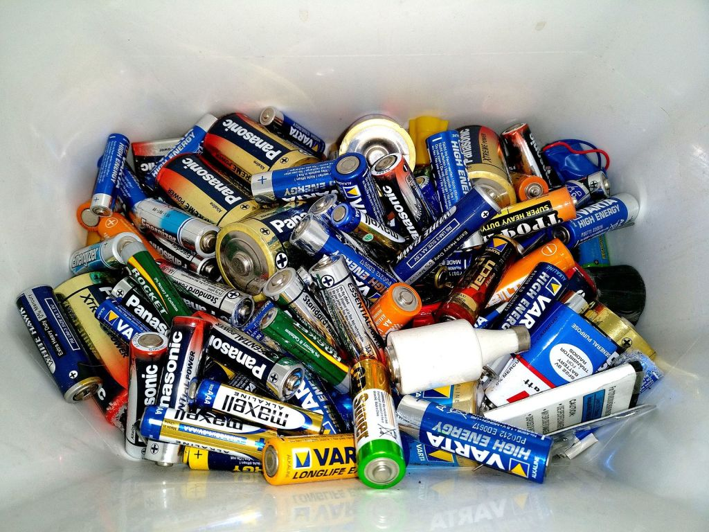 Photo of bucket of batteries of different varieties waiting appropriate disposal.