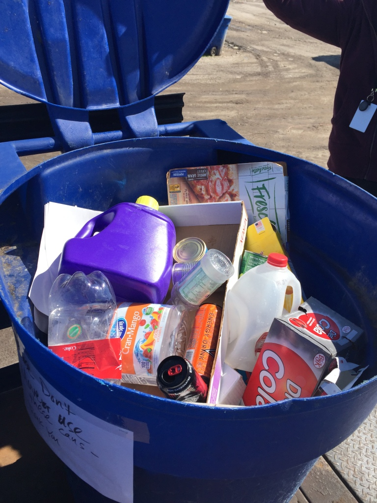 Phot of Salt lake City recycling bin with perfect materials - including empty and clean corrugated and paperboard boxes.